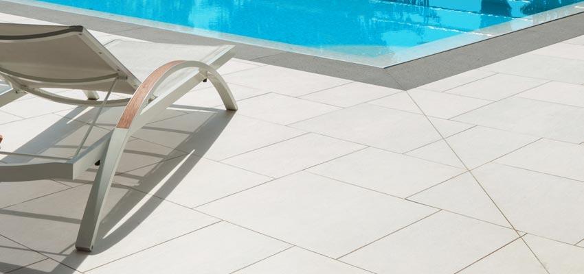 External porcelain paving tiles around a swimming pool